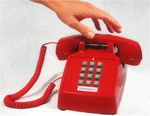 Hand reaching for the Emergency Phone