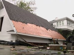 A damaged home with shingles missing from the roof in the aftermath of Hurricane Florence | New Bern, North Carolina